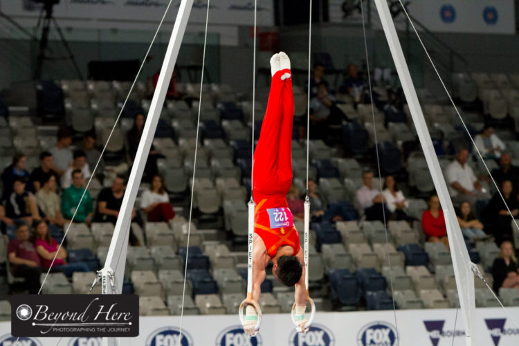 Male gymnast doing rings
