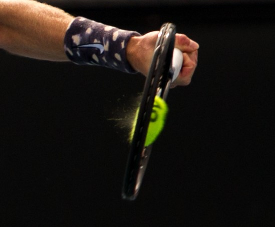 Close up of squashed tennis ball. Sports photographer Sally Jacob.
